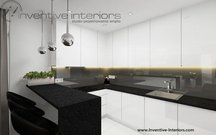Projekt kuchni Inventive Interiors - biała kuchnia z czarnym blatem i szarym szkłem