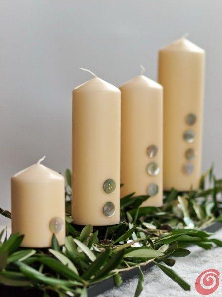 candele con bottoni in  madreperla