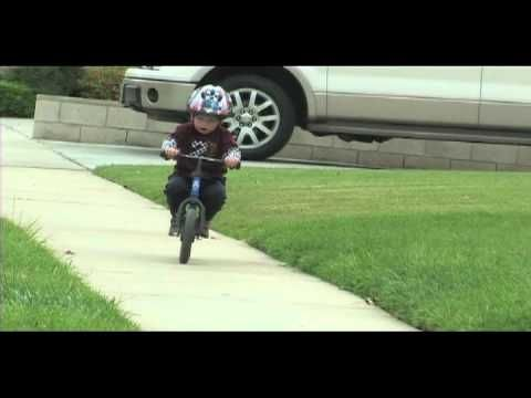 2 year old riding Strider balance bike