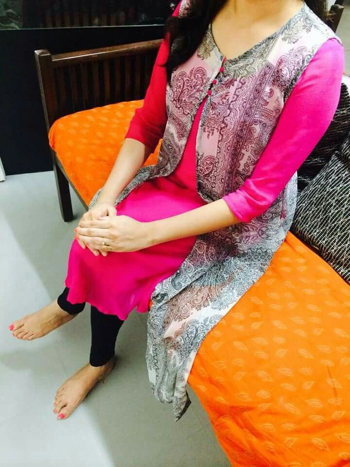Very pretty overcoat which can go about with Anu bright colour kurta