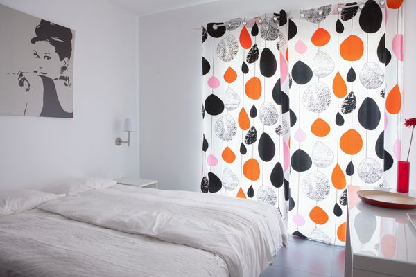Carina Villas Portugal - The first bedroom with Audrey Hepburn on your wall.