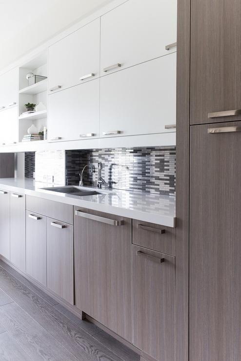 Modern Kitchen Boasts White Flat Front Upper Cabinets And Brown Oak Veneer Bottom Cabinets Adorned W Upper Kitchen Cabinets White Modern Kitchen Modern Kitchen