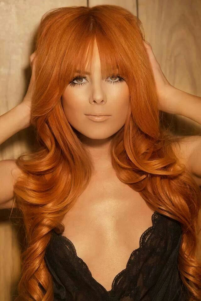 love the style of the hair; the color is a bit too coppery for my skin tone though. no link,  pic is of Candace Campbell