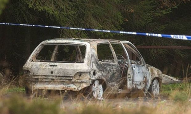 A burned car believed to have been used in the Northern Bank robbery
