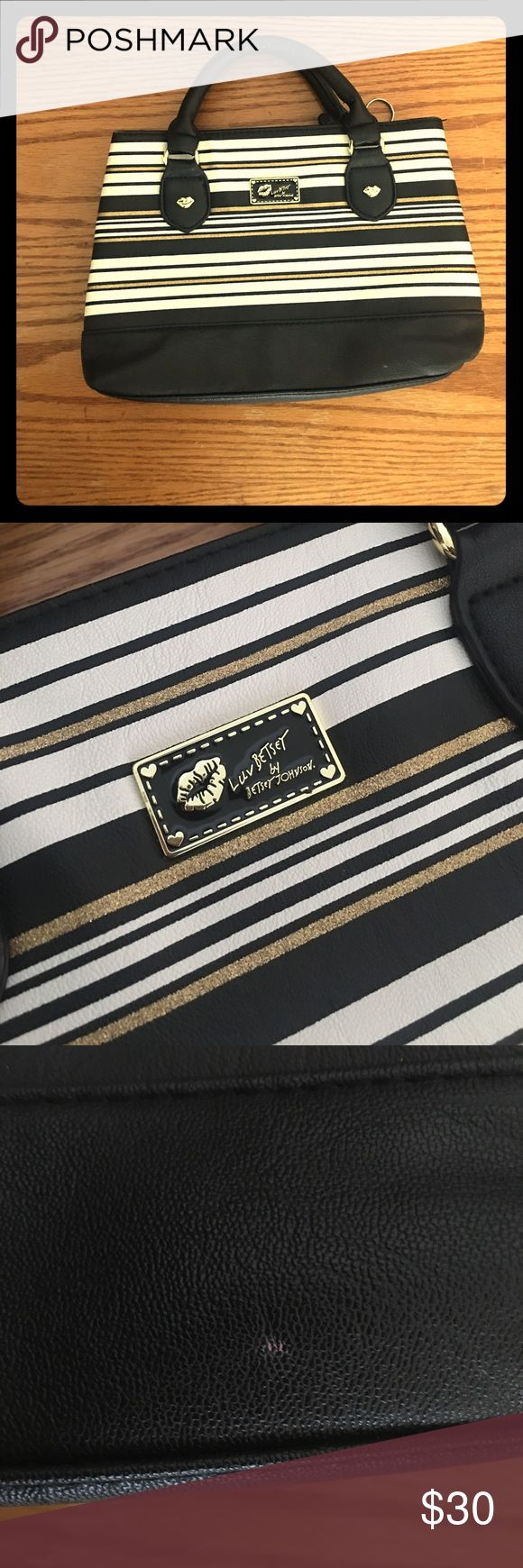 Luv Betsey by Betsey Johnson Black White Gold Mini Super cute mini purse. Luv Betsey by Betsey Johnson. Black white && gold. 11in X 7.5in. Used a few time but like new. Also the handles have some numbers written on it. I bought it like that. I will ship within 24hours most of the times. Please follow me as I will be cleaning my closet && posting a lot of clothes, shoes, makeup, bags, && a lot of other accessories. I am trying to make extra money to pay off student loans. Please ask any…