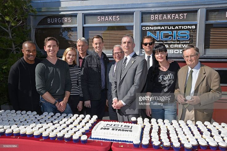 Actors Brian Dietzen, Rocky Carroll, Mark Harmon, Emily Wickersham and Sean Murray, executive producer Gary Glasberg, NCIS Director Andrew Traver and actors Michael Weatherly, Pauley Perrette and David McCallum attend the cake cutting celebration for 'NCIS' 300th episode on February 9, 2016 in Valencia, California.
