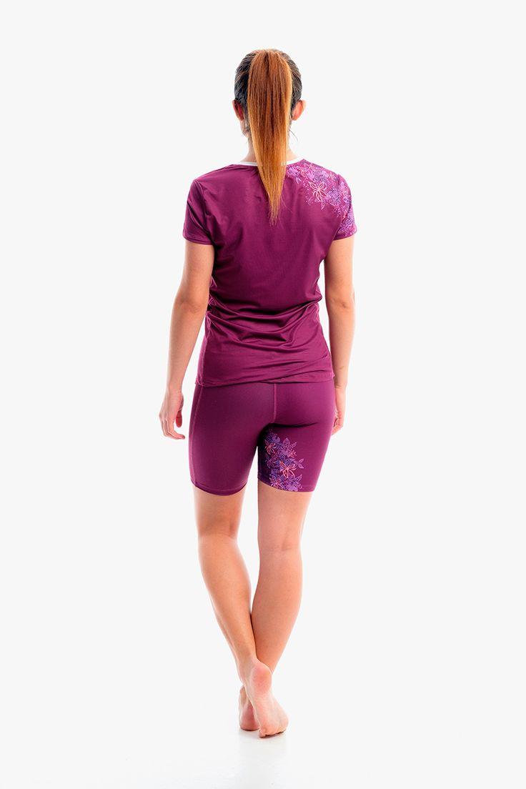 Vista trasera de conjunto de #running LILIUM para mujer. Si quieres ver el detalle de esta malla para #correr, haz clic en la imagen.