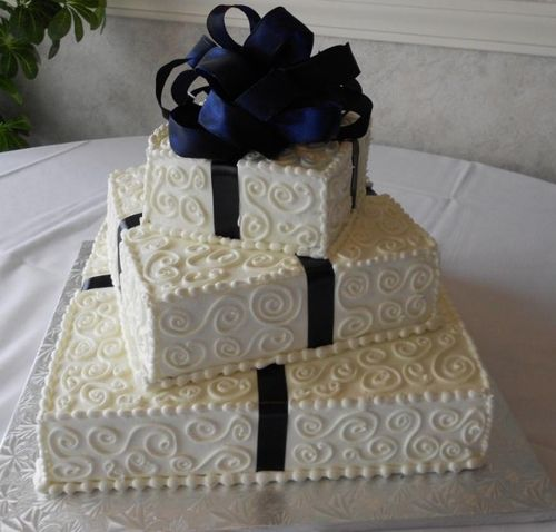 Square shaped wedding cakes.