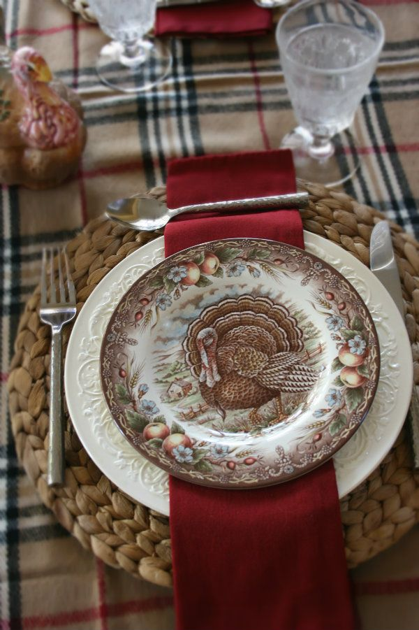 A variety of turkey plates look great with the colors in this plaid table scarf.  I just love the colors of fall!