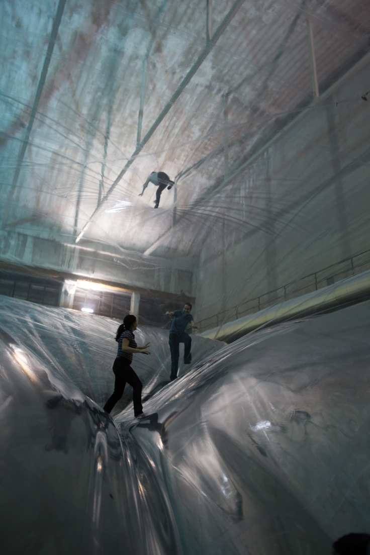 Tomás Saraceno - On Time Space Foam, 2012.  On Space Time Foam, a project created for HangarBicocca in Milan, Italy, is a multi-layered habitat of membranes suspended 24 meters above the ground that is inspired by cosmology and life sciences.