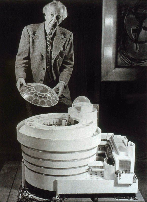 Frank Lloyd Wright in front of model of the Solomon R. Guggenheim Museum, New York, 1956