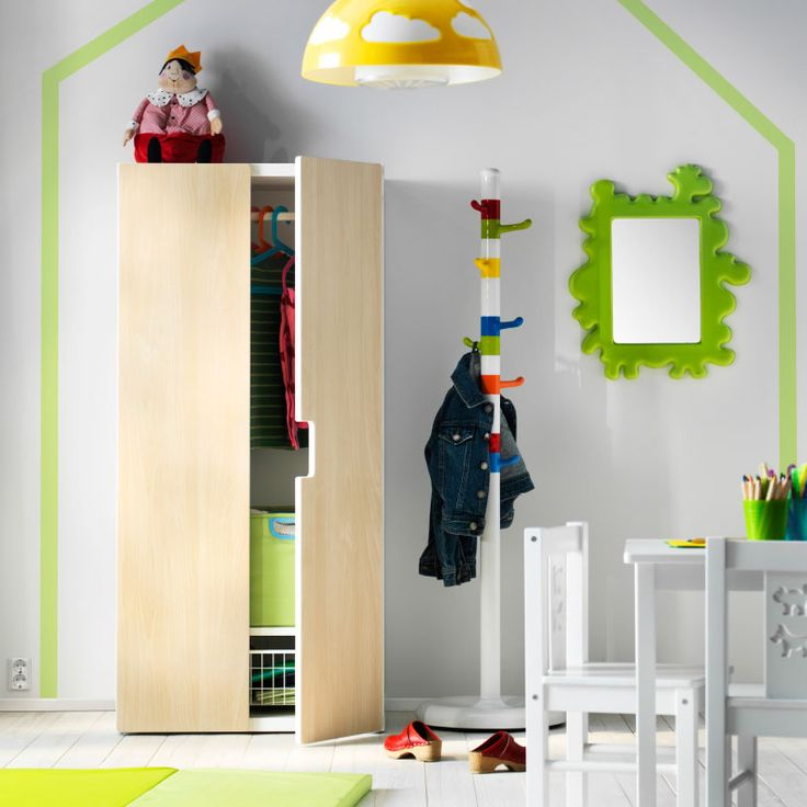 Playroom storage with a white STUVA wardrobe with birch doors and a multi-colored KROKIG clothes stand