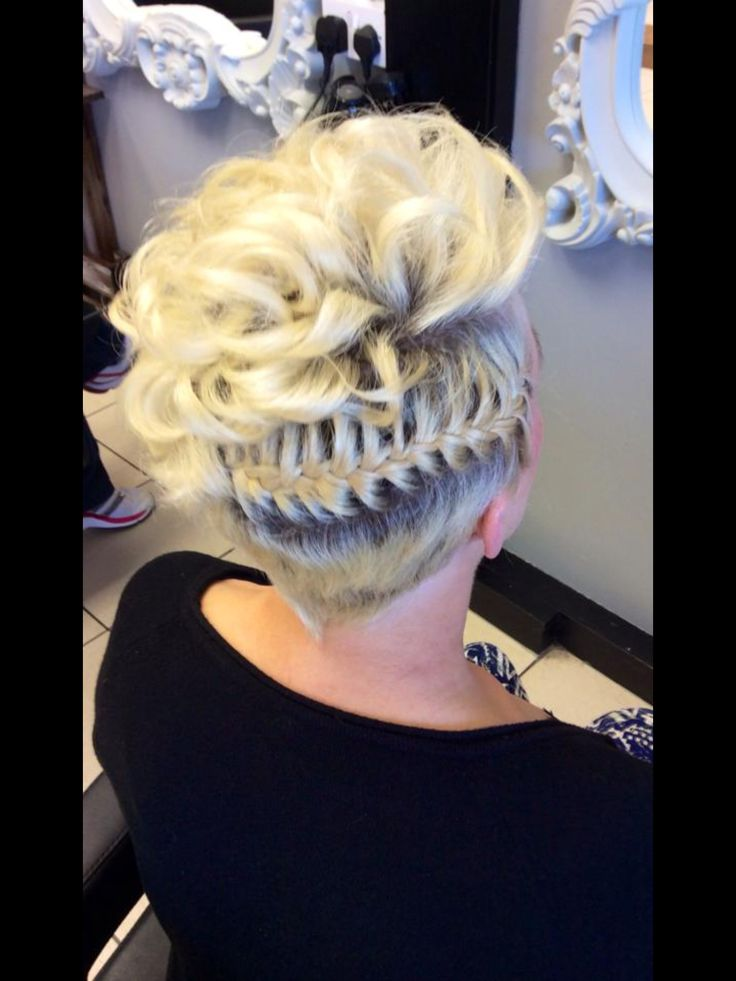 An upstyle for short hair, the top is backcombed curls with a scalp plait around one side