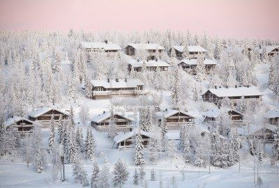 winter landscape with snow forest and wooden houses, Ruka village, Finland Stock Photo - 7935353