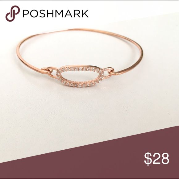 CZ Oval Bangle -Made of . 925 sterling silver with rose gold plated finish - Oval cut out design  with 1.5mm  CZ stones Condition- new/never used just WOT tag Jewelry Bracelets
