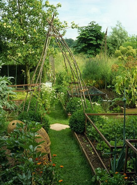 Like the beehive baskets, the tepees for vines to travel, the raised beds and the different enclosures for the vegetables, the soft grassy path -- what's not to like in this awesome garden. / Magic Garden <3