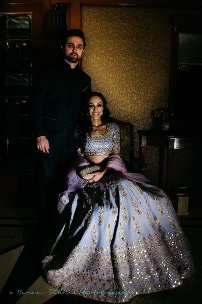 Sangeet Lehengas - Couple Shot | WedMeGood | Bride in a Lavender Lehenga with Silver Gotta Work and Groom in a Black Suit  #wedmegood #coupleshot #indianbride #indianwedding #lehenga #lavender #black
