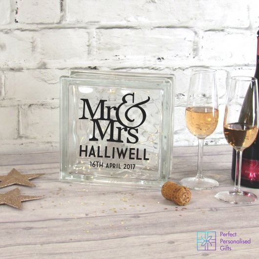 Mr & Mrs Wedding LED Glass Block.  This stunning and completely unique and brand new product is just beautiful. The glass block is filled with LED fairy light which means it looked stunning both during the day as a glass ornament and keepsake and add night when it can double up as a light. The black silhouette design then truly comes into its own with the lights twinkling behind it.  These make beautiful gifts for a wedding present but also an anniversary to remind you of your special day.