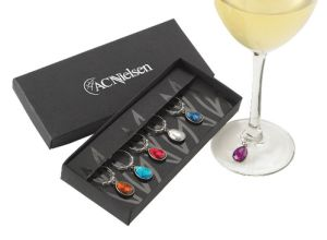 The Festival. Mark your glass with elegance. 6 colours: blue, orange, red, navy, purple and clear charms to mark your glass with perfection Comes in an elegant gift box.