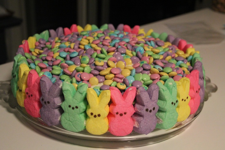 Easter Cake Decorated with Bunny Peeps on the Side and Pastel M on Top