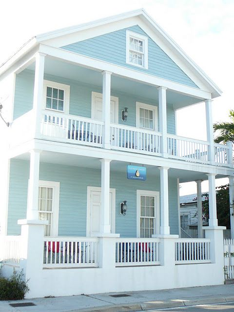 blue green exterior paint with a white trim beachy