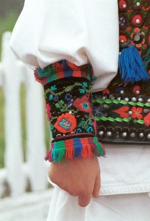 Romanian mens costume from Maramureş Decorated cuffs (mânecări ) made of black velvet embroidered with floral motifs in brightly coloured wool Photo taken in Bârsana, Valea Izei, Maramureş in April 2002