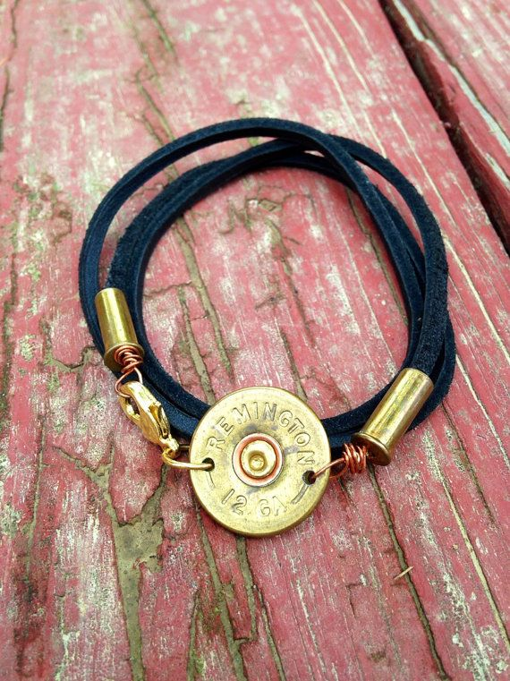 Leather wrap bracelet with 12 shotgun shell head! Has two .22 shells as well!! When you order please let me know what size you would like! Smalls are around 21.5 inches long, mediums are around 23.5, and larges around 25.5.  My jewelry is handcreated with thought and love in each one. No two pieces are alike.