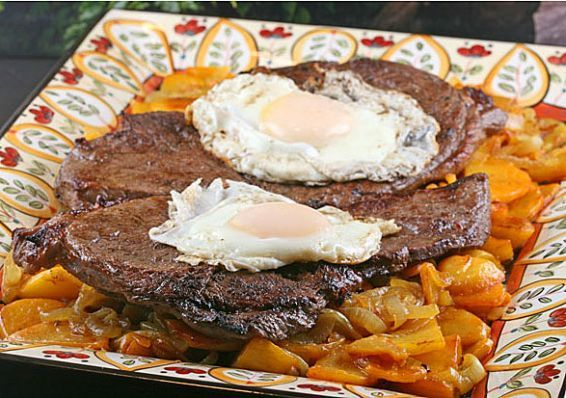 Bistec a lo pobre. Traditional chilean dish....