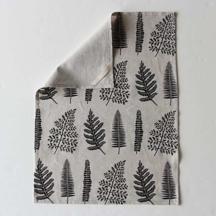 Ferns tea towel by Amelie Mancini, she uses hand-carved linocuts and silk screens to print her elegant designs onto linen and create original and artful tableware, home decor and accessories