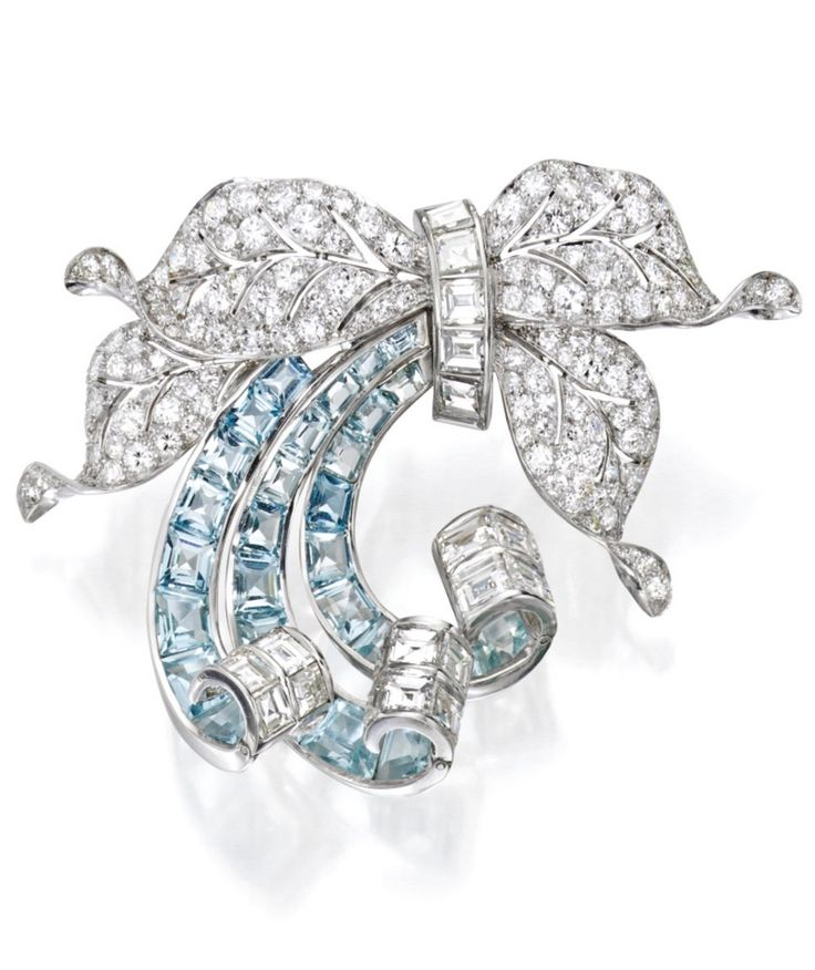 Paul Flato - A Vintage Platinum, Diamond and Aquamarine Brooch, Circa 1940. Of foliate design decorated with ribbon scrolls, set with round and single-cut diamonds, accented by square-cut diamonds, further set with 28 calibré-cut aquamarines, signed Flato. #Flato #vintage #brooch