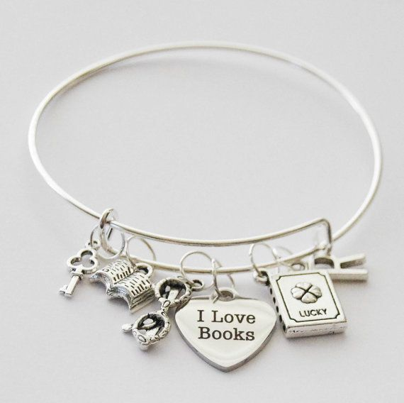 The perfect book lover gift!  This beautiful bangle was handmade with love by me using a laser-engraved stainless steel I Love Books heart pendant, a silver-plated skeleton key charm, a reading glasses charm, an open book charm, and a lucky book charm on an adjustable zinc alloy