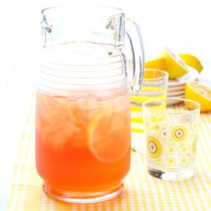 Raspberry Ice Tea Recipe -Frozen raspberries lend fruity flavor and lovely color to this pretty iced tea. The recipe calls for just a few common ingredients and offers make-ahead convenience. —Lois McGrady, Hillsville, Virginia