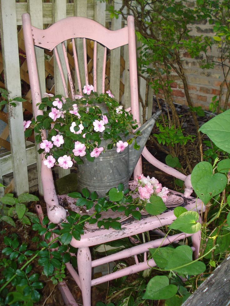 Old rocking chair painted pink, in my garden.