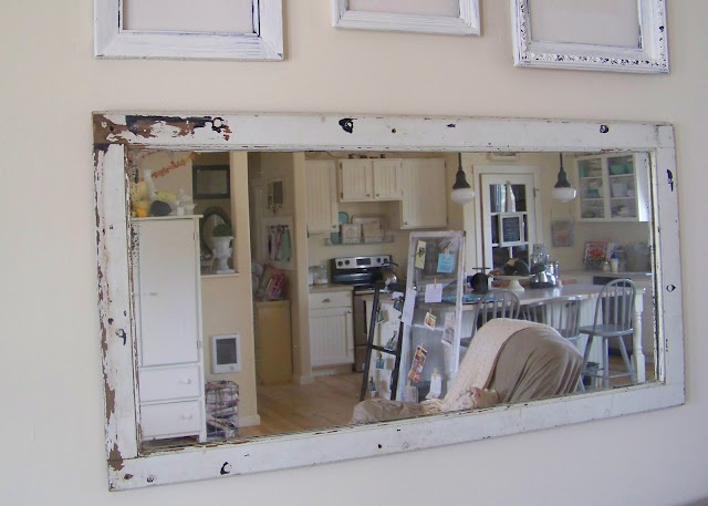 A mirror was placed inside this old frame-It looks great!  See more fun ideas for old or new window frames