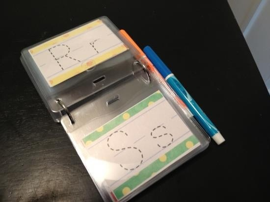 Dry Erase traceable letters in a small photo album. Great Idea!