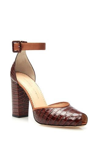 Elegantly crafted, exquisite designs inspired by the charisma of Old Hollywood lie at the heart of London-based label **Charlotte Olympia**. With a sturdy heel and grosgrain ankle strap and crafted from a rich brown croc embossed calf leather, these Charlotte Olympie Renée ankle strap pumps deliver 70's-inspired style with thoroughly modern elegance.