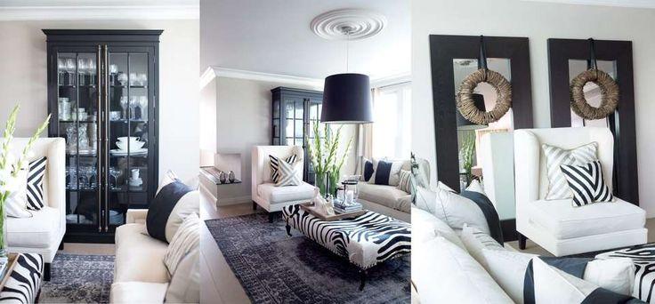 STUEN: Den hvite lenestolen er av merket La Fibule og blir ofte brukt som hotellmøbel. De beige sofaene er fra Andrew Martin. Puff i sebraskinn fra interiørbutikken The One i Dubai. Alle puter er egendesignet; både disse, stolen og teppet selges gjennom Governato Design. Figur i hvit sten er kjøpt på Vestkantorget i Oslo. I boligen er det alltid tente duftlys og friske blomster; to av Angelas must-haves. I det sorte vitrine-skapet står en samling krystallglass. - Jeg er veldig glad i…