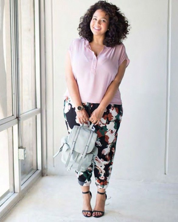 Lavender top, patterned pants, black heels, and grey leather backpack.
