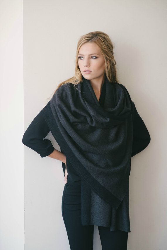 This year's fall/winter accessory essential is the scarf wrap. This endlessly cozy scarf is made of a medium-weight nubby boucle wool-blend knit that