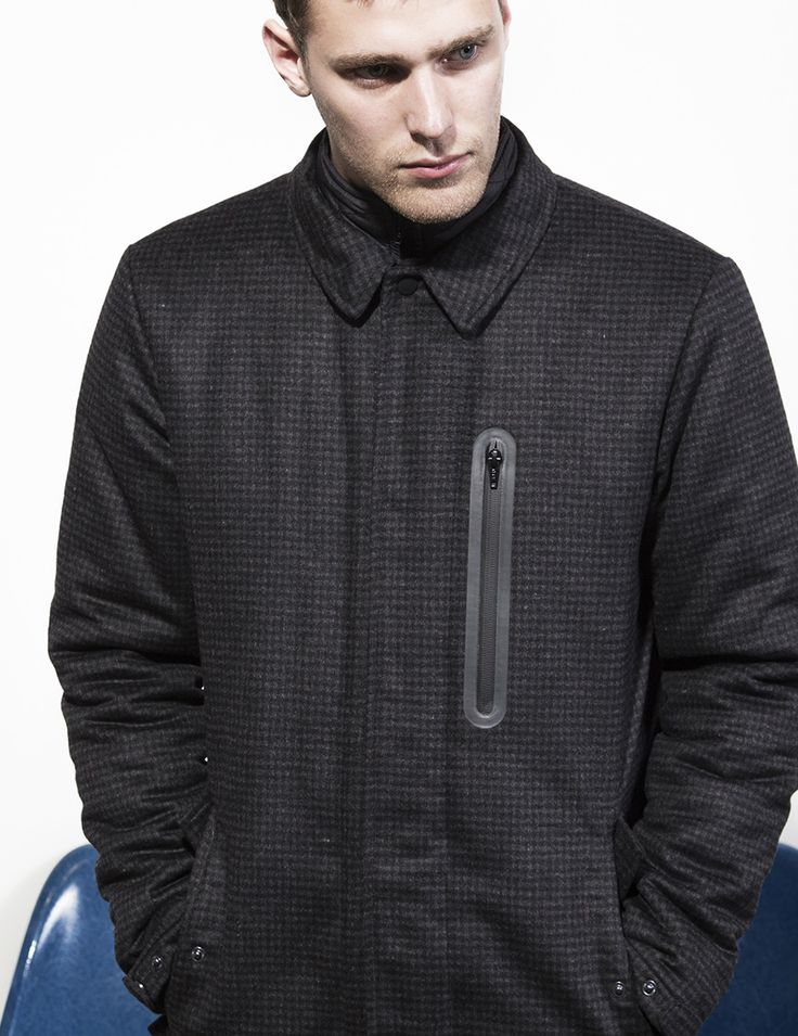 RVLT - men's fashion. A funtional yet truly modern fall jacket. The jacket is made of a heavy wool blend fabric with subtle checks.