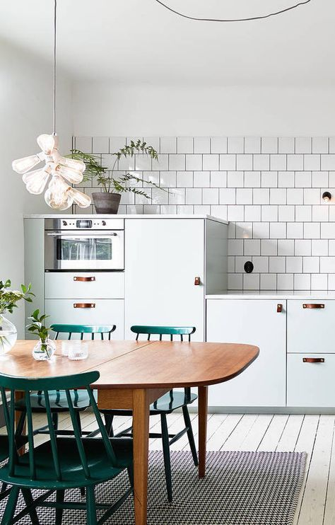 Cute vintage modern kitchen // green chairs // white tiles and cabinets