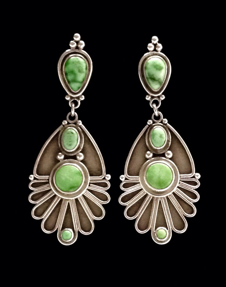 Earrings by Annelise Williamson set with carico lake turquoise