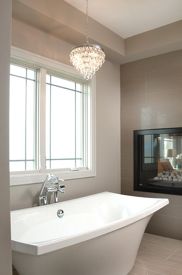 How cozy it would be to soak in the tub while  watching the flames in the built-in fireplace! www.ironwoodiowa.com www.gilcrestjewett.com   www.windsorwindows.com  www.dmhomeshow.com