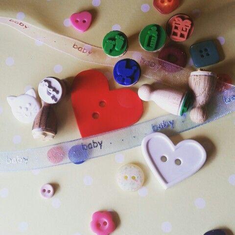 Baby stamp set containing 8 Ministempel designs (#present, #gender (#boy & #girl stamps), #stork, #babybottle, #pram / #stroller, #footprints & #pacifier) + #inkpad  Available from www.annieponline.com