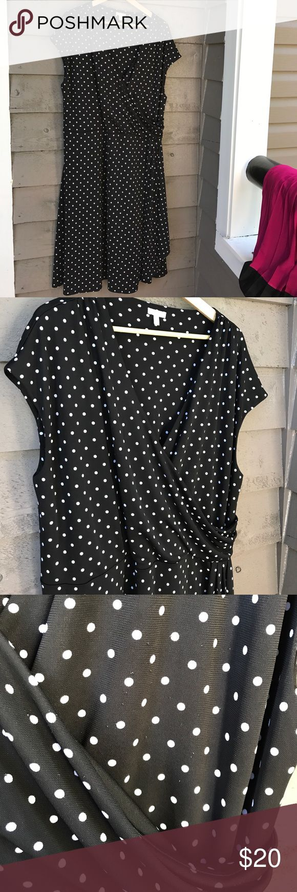 Talbots polka dot dress Talbots black and white polka dot dress . On one side of the dress you will find a small picky spots that are in the pictures . They are not very noticeable but I have discounted this dress based on that. The dress will be very flattering. talbots Dresses