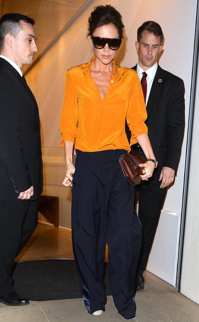 Victoria Beckham from The Big Picture: Today's Hot Photos The chic fashion designer is spotted leaving her London boutique in an orange button up blouse and navy flares.