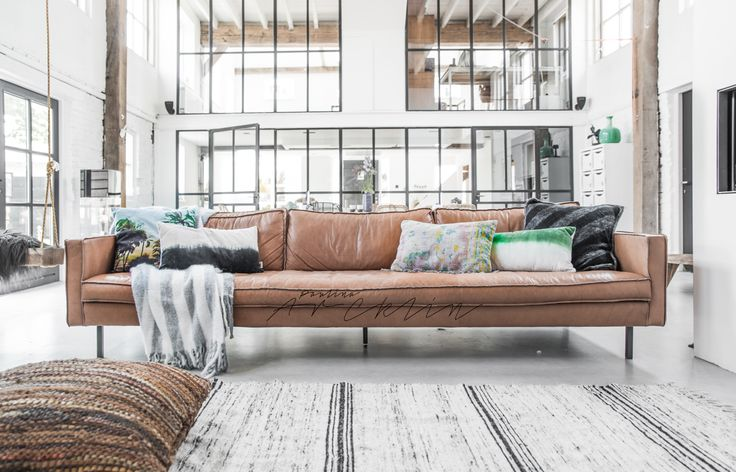 industrial look and vintage cognac leather sofa to cosy it up.