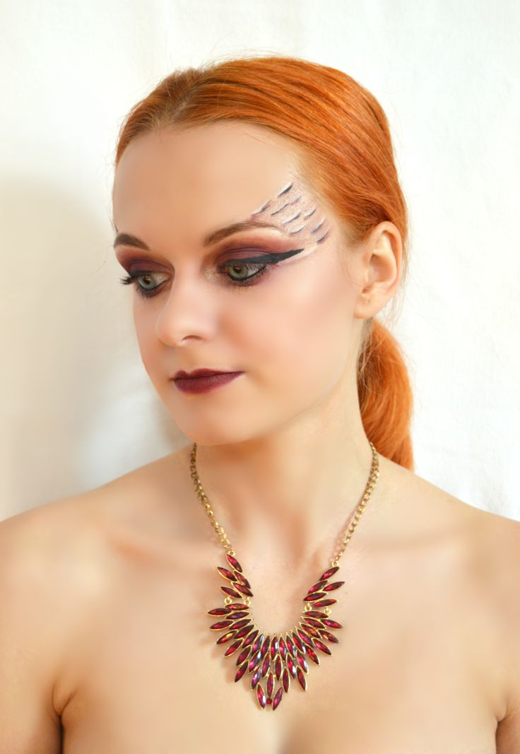 Makeup photoshoot with extravagant makeup and necklace.