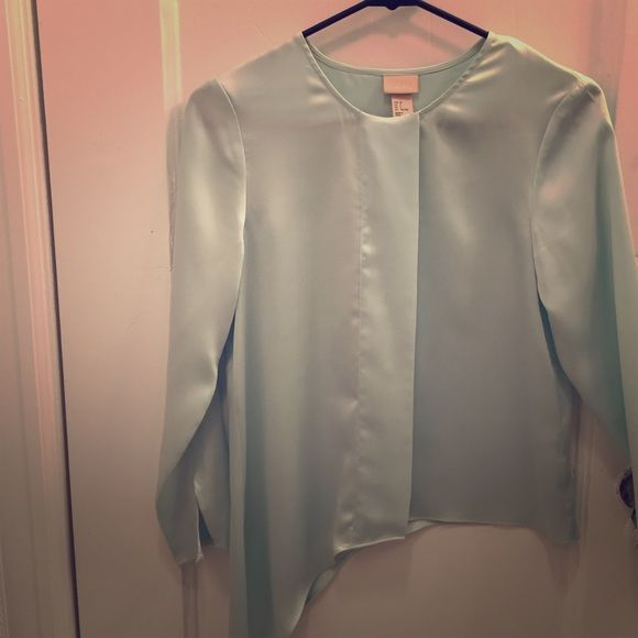 Asymmetrical long sleeve mint shirt. Asymmetrical long sleeve mint shirt. Buttons are hidden. There is a few slight pills that I have pictured, but you can hardly notice them. H&M Tops Blouses