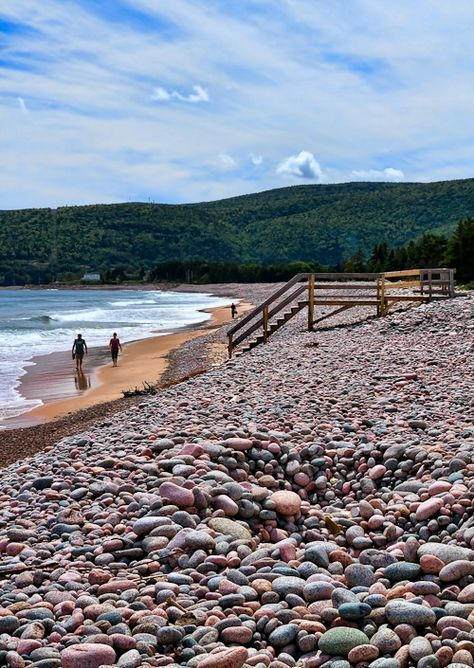 Ingonish Beach, Nova Scotia - Ingonish Beach in the Cape Breton Highlands is covered with the most beautiful round pink stones. #Travel